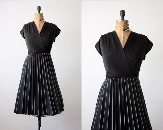 RESERVED. vintage 1970's black wrap dress