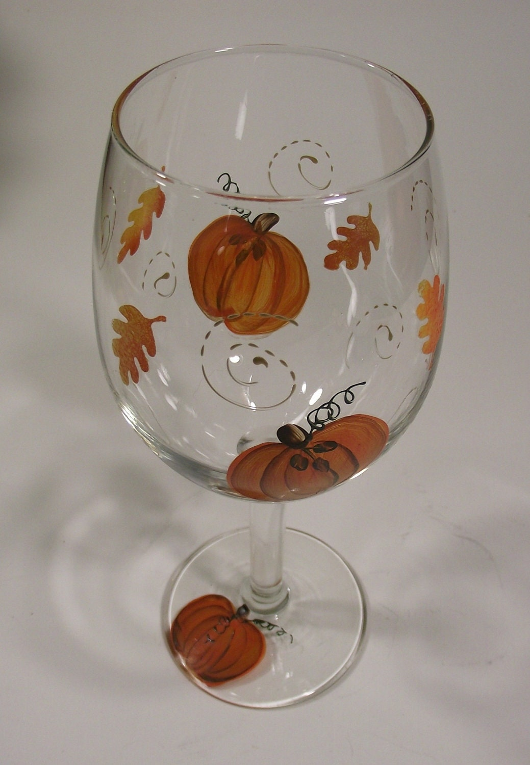 hand painted fall pumpkin leaves and swirls wine by