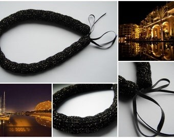 Night out in the city - black with gold crocheted tube necklace with satin black ribbon
