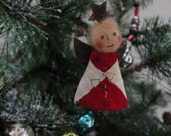 Antique Red And White Quilt Angel Christmas Ornament Named A Rising Star