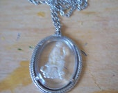 Vintage Avon Pendant Necklace.carving of hunting maiden with her dog