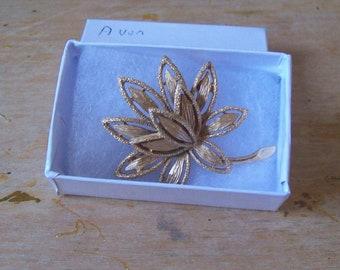 Avon vintage flower brooch  Avon Golden Layered Flower Brooch.
