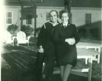 Navy Sailor and Woman in Uniform Military Couple Sitting on Base 1940s WW2 Vintage Photo Black and White Photograph