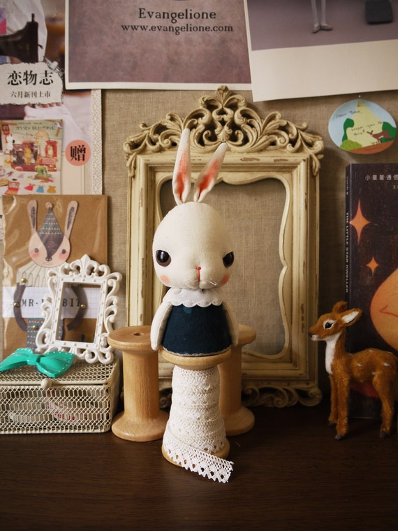 Bunny on a wooden spool