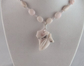 Beautiful light pink opal flower necklace.