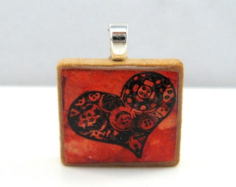 Red copper heart  - metallic Scrabble tile pendant with button image
