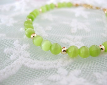 Lime green cats eye beaded bracelet. Simple and unique.