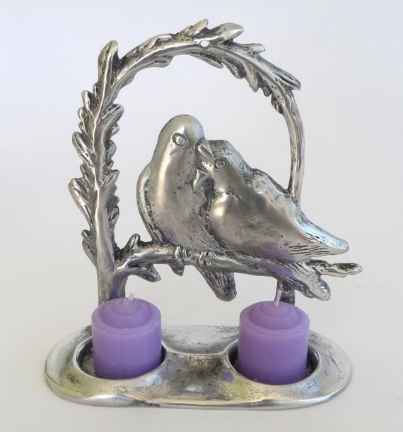 Candles holder for two candles, birds design, made of cast aluminum polished to shine like silver made by Shaul Baz
