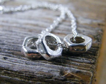 tiny ring necklace organic shapes of sterling silver