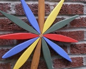 Colorful Starburst Wreath Garden Wall Art (red blue yellow green & natl) - handcrafted by Laughing Creek