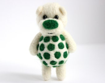 Pure white pocket bear with deep green polka dots