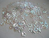 7 g of 6 mm 5 Petals Flower Sequins in Clear Iridescent Color