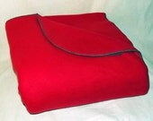 Possum Pouch Fleece Blanket with a Foot and Leg Pouch featuring a Bright Red Color with a Medium Green Serged Edge Trim (size long)