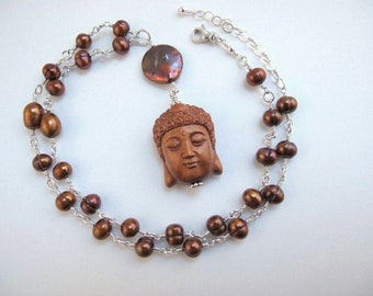 Buddha and The Pearls Necklace
