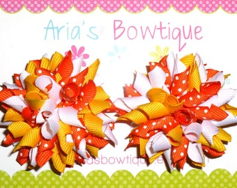 A Pair Of Candy Corn Dots Mini Korker Hair Bows