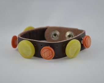Brown leather bracelet with orange & yellow vintage buttons