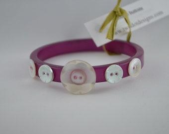 Pink vintage bangle bracelet with pale blue & white flower vintage buttons