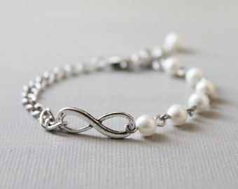 Infinity Bracelet. antique silver infinity ring with Swarovski crystal pearls.