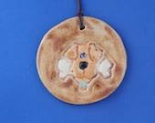 Pottery dog Christmas ornament