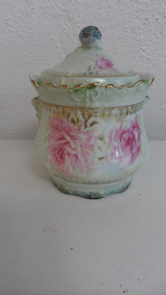 antique 1890-1930 has a mark  nippon jar gilded footed scalloped edges  embossed  has nippon rising sun mark in blue  mint green pink roses