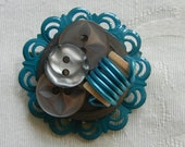 Teal and gray button pin with spool
