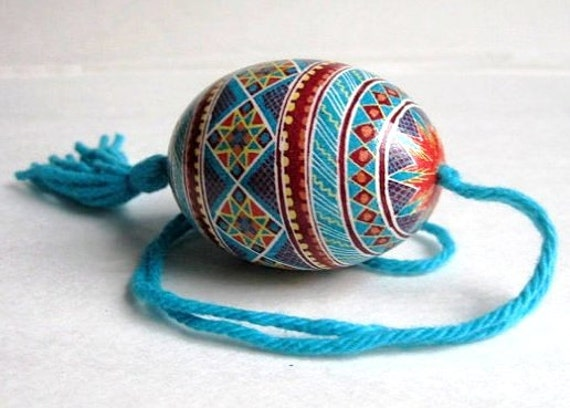 Dark red with Turquoise chicken pysanka on a string