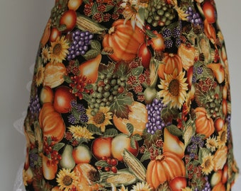 Hostess apron in vegetable and fruit print - orange, gold, purple, gold