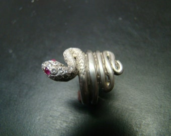 Elegant Sterling silver snake ring with genuine diamonds and rubies