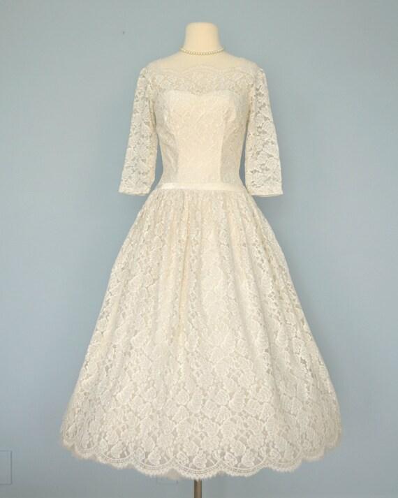 RESERVED..Vintage Lace Wedding Dress...Beautiful Ivory Tea
