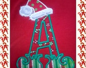 Personalized Santa hat and Elf shoes Tees.