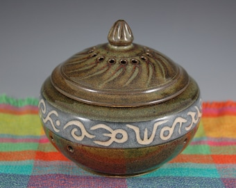 Brown carved  stoneware lidded garlic keeper