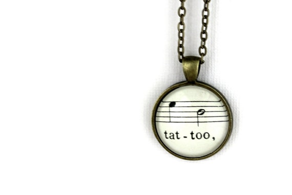 Tattoo pendant necklace vintage style made with vintage sheet music under glass.  Black and white music accessory jewelry for women