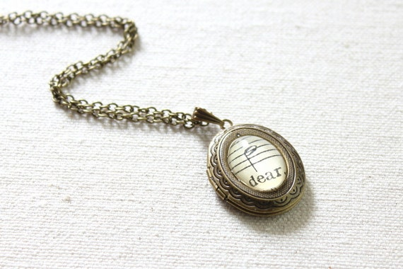 Vintage style locket made with vintage sheet music under glass.  Romantic gift for wife, girlfriend, fiancee, friend