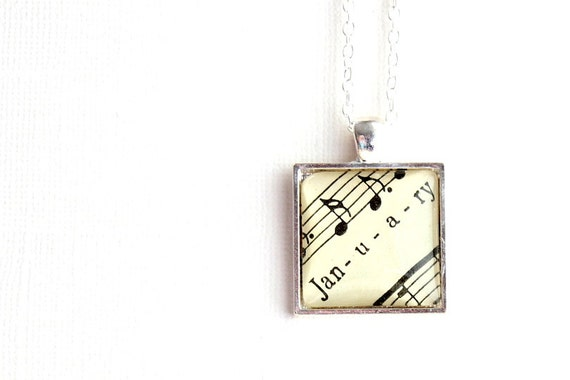 January birthday necklace made from vintage sheet music in silver plated square pendant with puffy glass