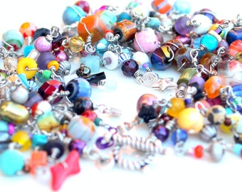 friendship bracelet. layered rainbow. bracelet. multicolored beads. sterling silver clasp. tactile heaven.