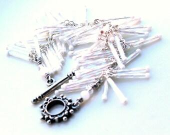 wrap bracelet. white snow drops. bracelet. christmas gift. bridal bracelet. glossy. wire wrapped bugle beads. seed beads. flowerclasp.