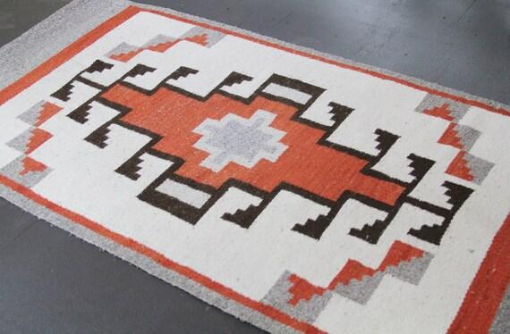 antique brown and orange navajo rug