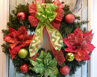 Christmas wreath red and lime green ornaments, poinsettia and bow