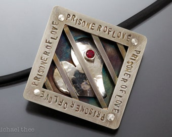 Prisoner of Love Pendant: Fabricated Sterling Silver and Red Topaz