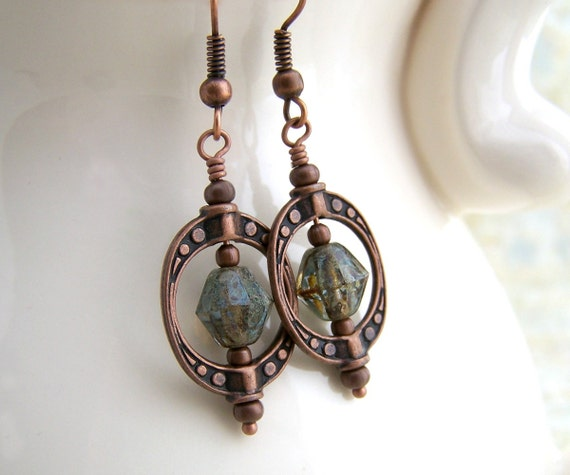 Green Steampunk Earrings with spinning Saturn bead frames of copper - Green earrings of Czech glass beads with a Picasso finish