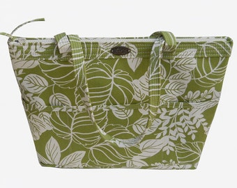 Green fabric purse // zip top // outside pockets // inside pockets // green and white leaf