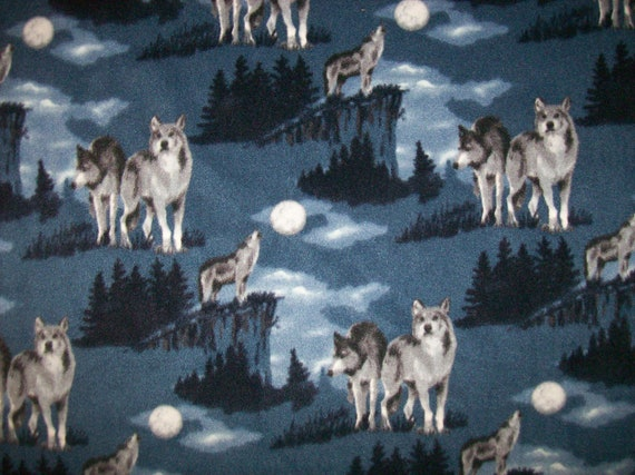 A gorgeous wolves howling at the moon by countrycharmfabrics for Moon fleece fabric
