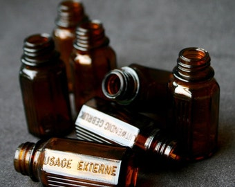 External use only. Vintage French vials for Halloween potion.
