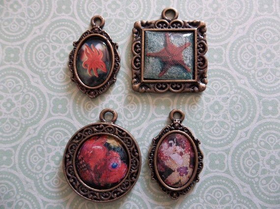 30% OFF SALE: Set of 4 Framed Fish Charms - Starfish Goldfish Sea Anemone in Antiqued Oxidized Brass