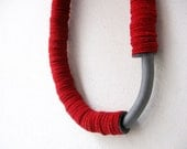 red felt geometric tube bold necklace with a ceramic grey curve bead-contemporary jewelry