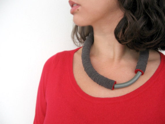 grey tube minimal geometric necklace with an arc ceramic bead and a red touch