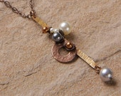 Lines and Dots necklace: Hammered brass bar wire wrapped with Swarovski pearls, copper washer