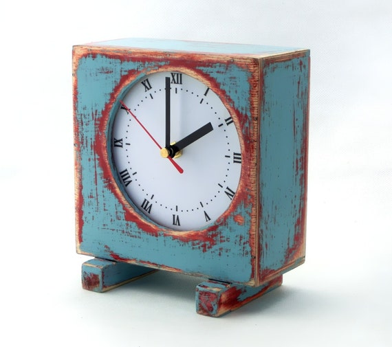 Desk clock turquoise blue sky pink wooden table