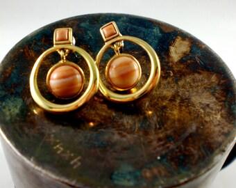 Gold and orange dangle earrings