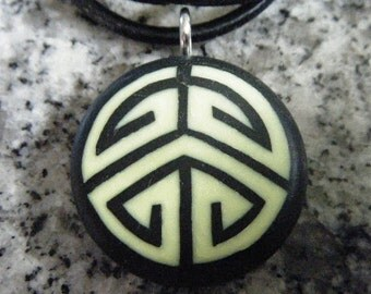 Puzzle hand carved on a polymer clay black color background. Pendant comes with a FREE Necklace